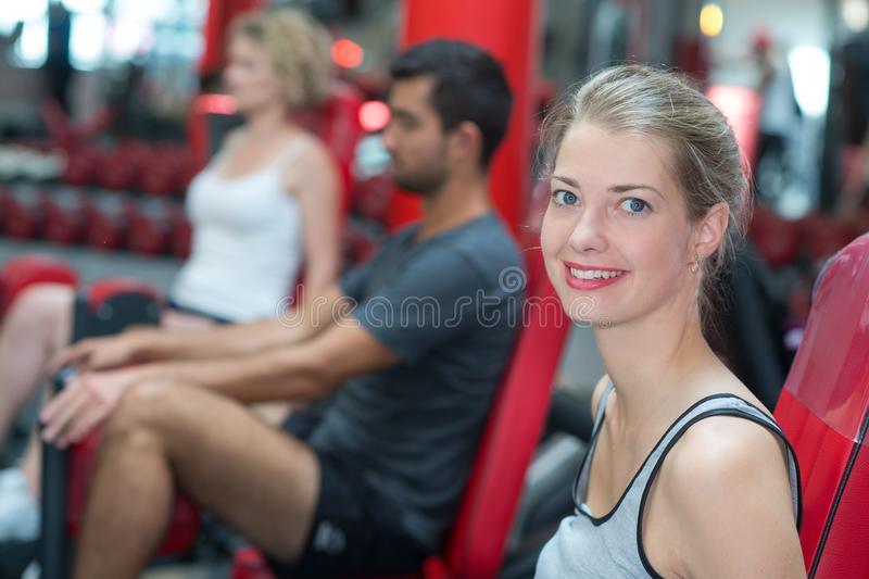 Happy woman exercising at gym stock photos