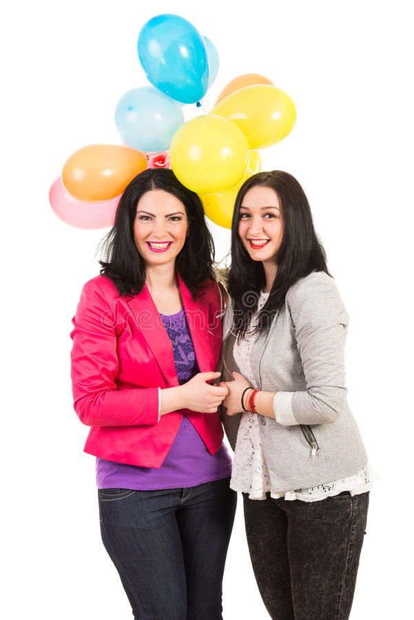 Happy women friends with balloons royalty free stock photo