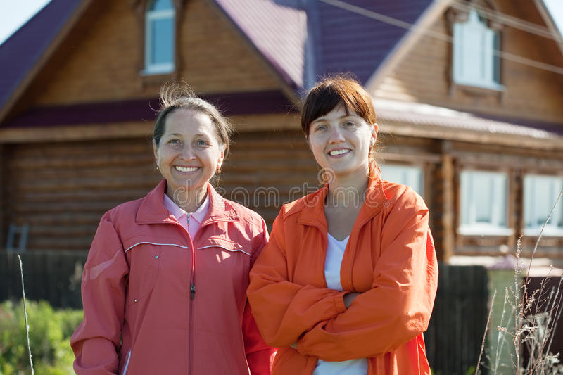 Download Happy Women  In Front Of  Home Royalty Free Stock Image - Image: 22256466