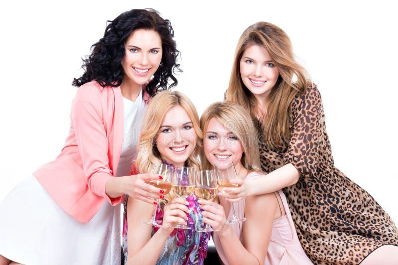 Happy women with glasses of wine. stock image