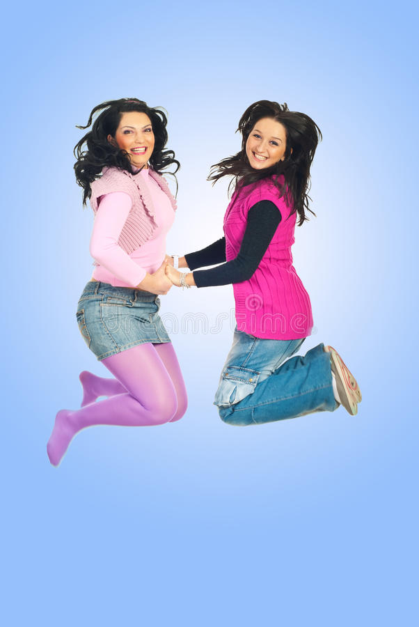 Happy women jumping stock photos