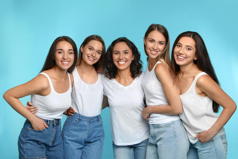 Happy women on light blue background stock images