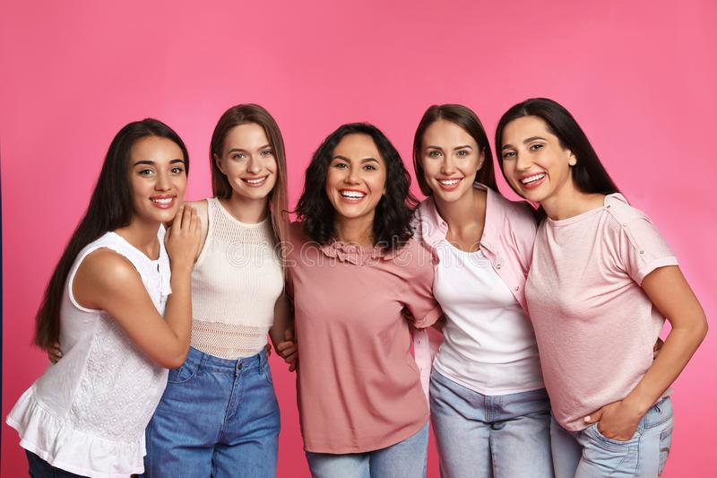 Happy women on pink background royalty free stock photo