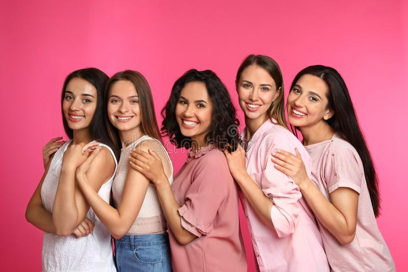 Happy women on pink background royalty free stock image