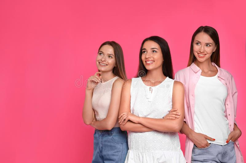 Happy women on pink background. Girl power concept stock photos