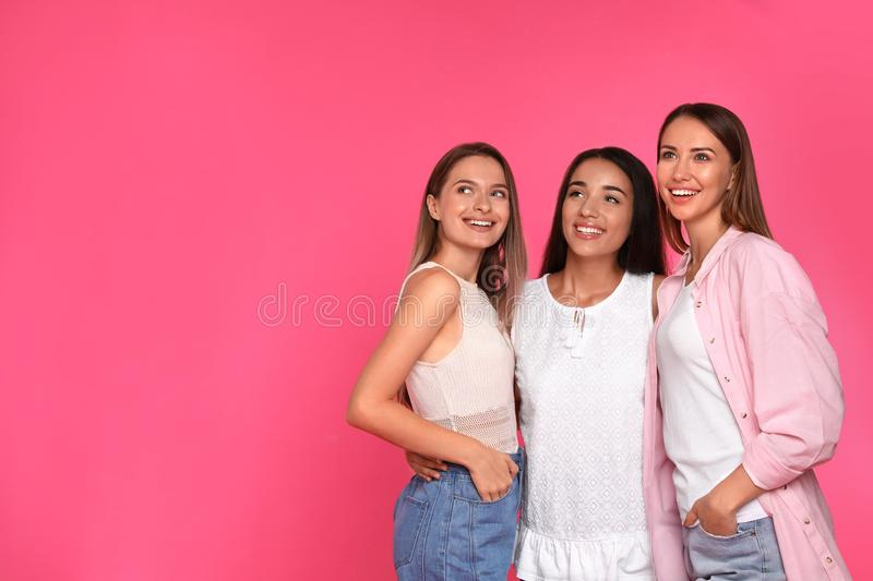 Happy women on pink background. Girl power concept stock images