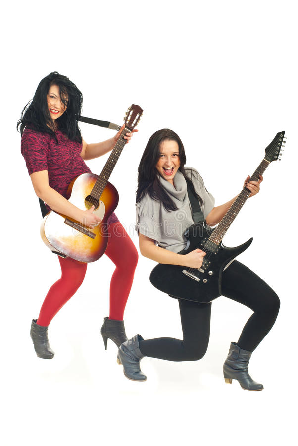 Happy women playing guitars stock photography