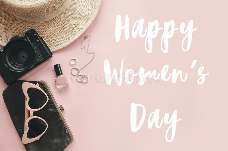 Happy Women`s Day text sign at stylish girly photo camera, retro sunglasses, jewelry, hat on pastel pink paper. Girl Power. International womens day, 8 march vector illustration