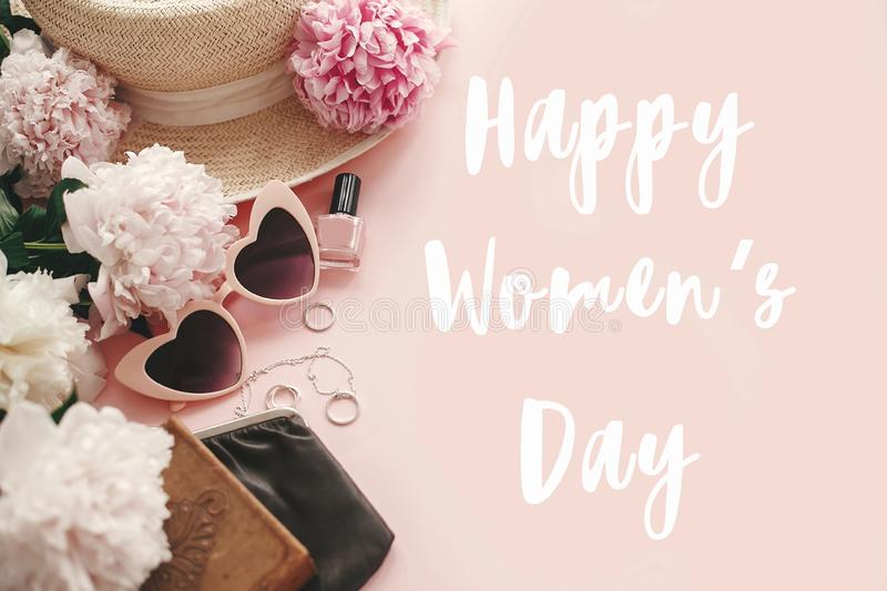 Happy Women`s Day text sign at stylish girly pink retro sunglasses,peonies, jewelry, hat, purse,cosmetics on pastel pink paper. Flat lay. Girl Power stock illustration