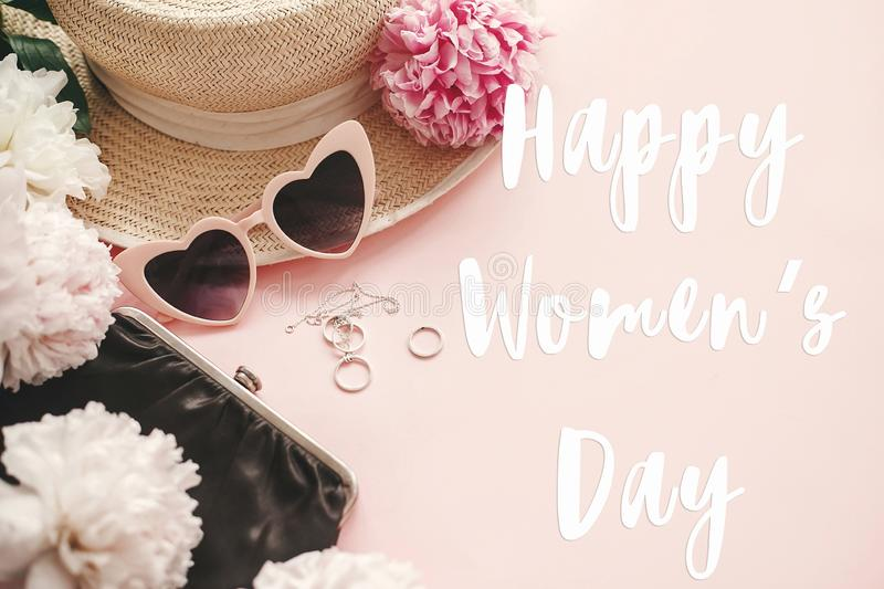 Happy Women`s Day text sign at stylish girly pink retro sunglasses,peonies, jewelry, hat, purse on pastel pink paper flat lay. Girl Power. International womens stock illustration
