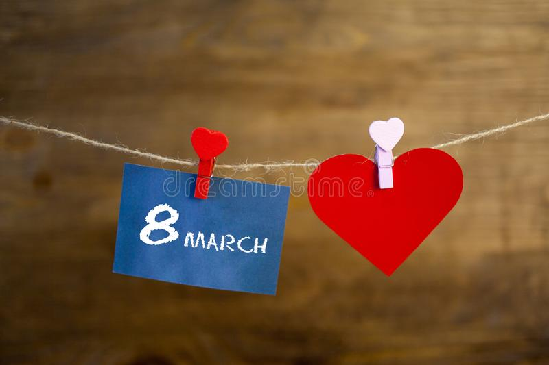Happy Women`s Day text written with chalk on the stickers and red heart royalty free stock images