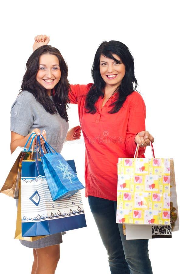 Happy women shoppers cheering stock image