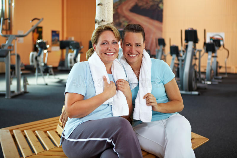 Download Happy women sitting in gym stock image. Image of healthy - 16958083