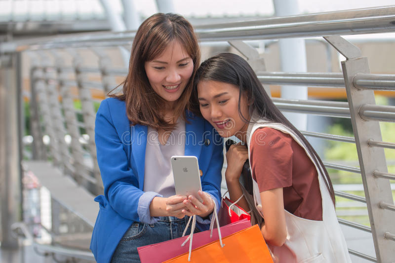 Happy Women Taking Selfie after Shopping. Taking Selfie. And Sharing Photos on Social Networks is very common and fashion at the moment royalty free stock photography
