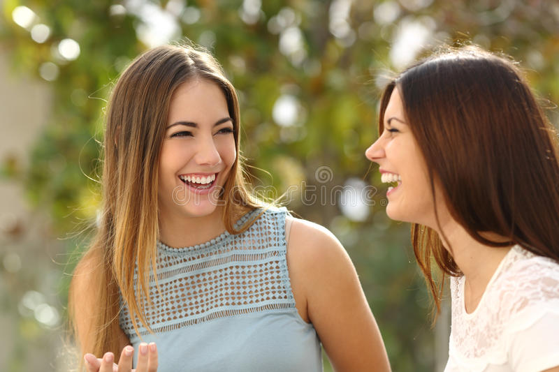 Happy women talking and laughing stock images