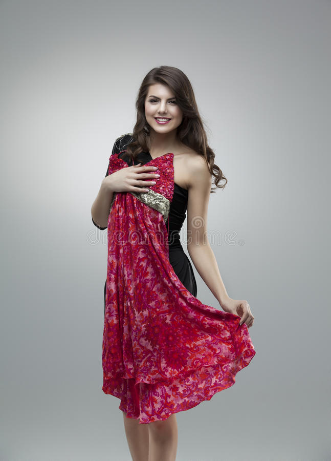 Happy women trying red flower dress royalty free stock images