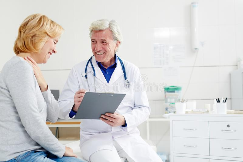 Female patient. Happy women visiting a doctor. She is getting a good analysis stock photos