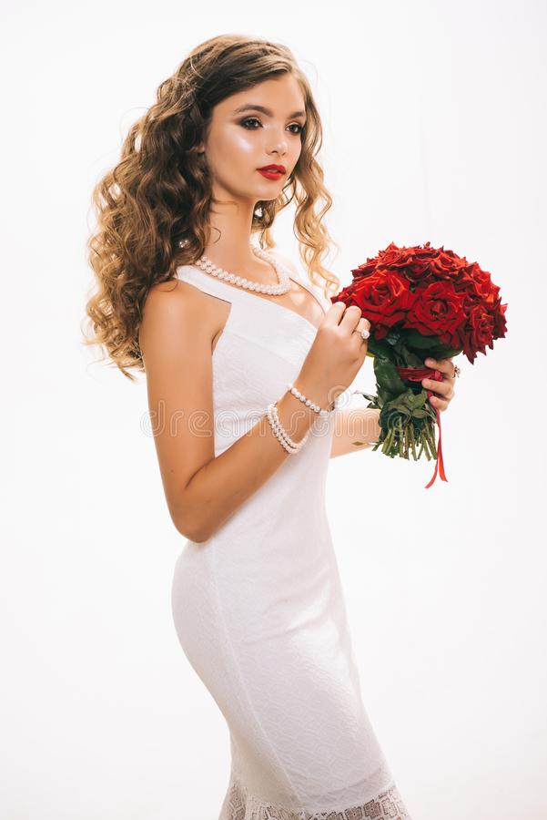 Happy womens day or 8 march celebration. Young woman smile with fresh flowers. Happy woman hold red roses. Pretty woman stock photos