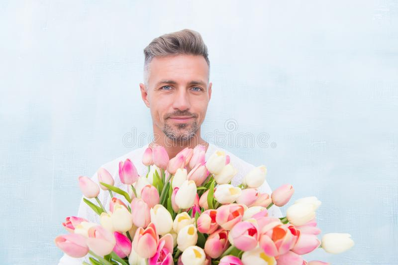 Happy womens day. For someone special. Man with tulips bouquet. Handsome guy holding pink flowers. Attractive man with royalty free stock photo