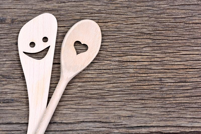 Happy wooden spoons on rustic table stock image