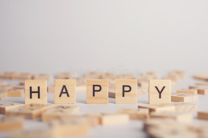 HAPPY wooden tile font stock fotografie