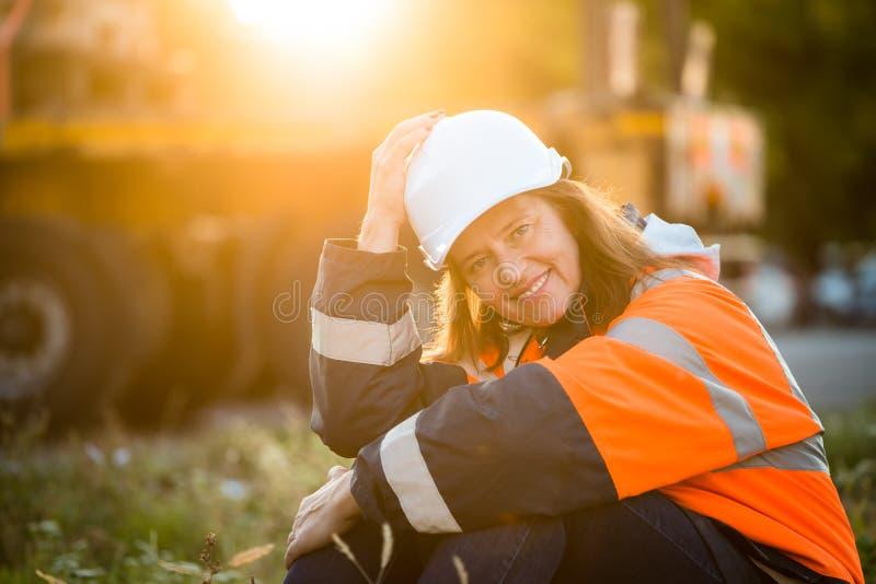 Happy in work - senior woman engineer royalty free stock images