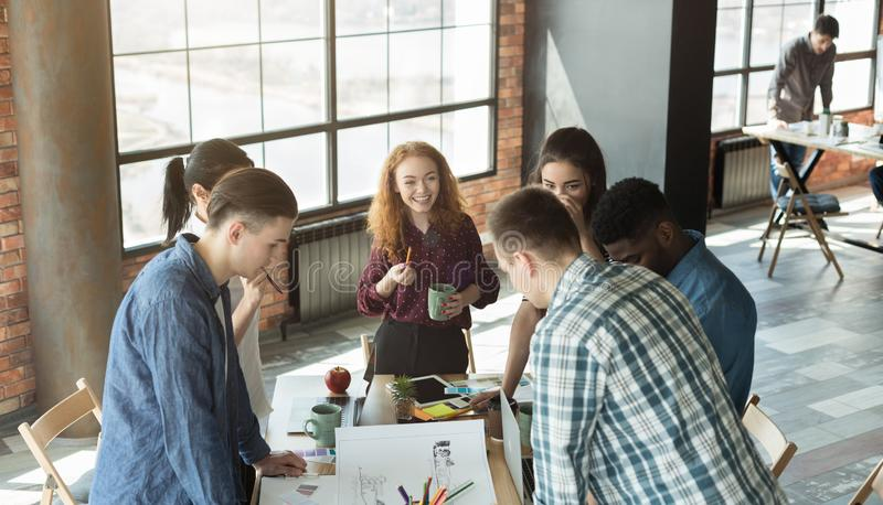 Group of multiethnic designers brainstorming in office stock image