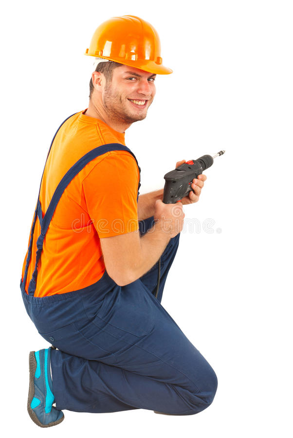 Happy worker with drill. Isolated on white background stock image