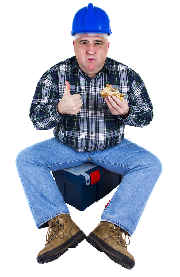 Happy worker enjoying his hamburger royalty free stock photography