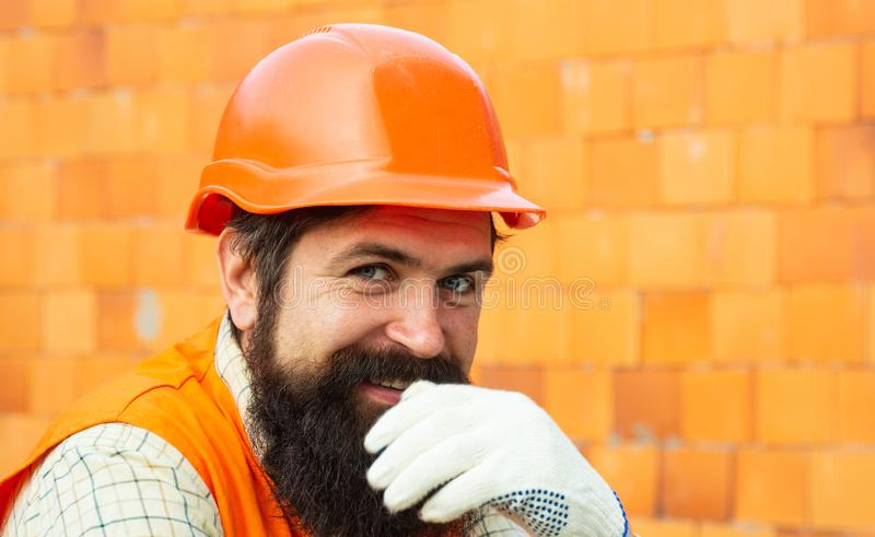 Happy worker. Good job. Career in the construction business. Developer. New apartments. The property. Real estate market. Builder profession. New sweet home stock images