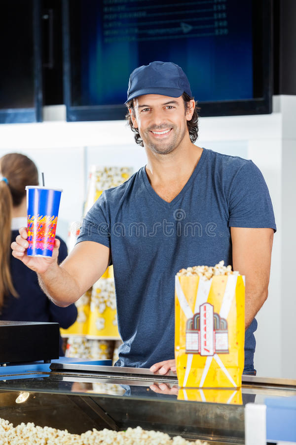 Happy Worker Holding Drink At Cinema Concession Stock Image - Image ...