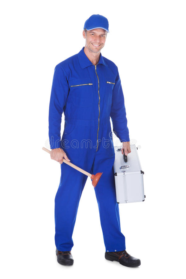 Happy Worker Holding Toolkit And Plunger. Over White Background royalty free stock photo