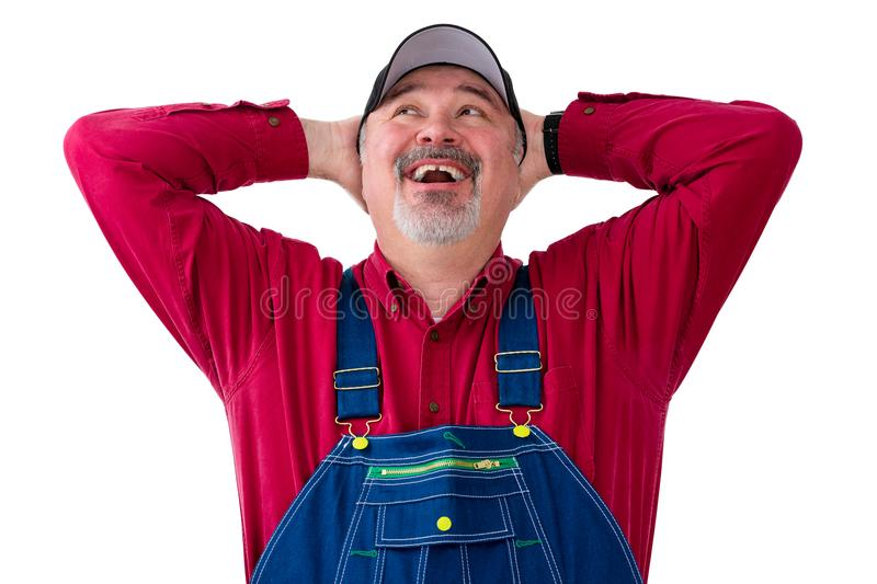 Happy worker wearing dungarees on white background royalty free stock photos