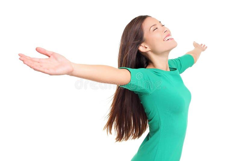 Happy worshipping praising joyful elated woman stock photo