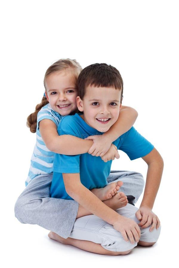 Happy wrestling kids stock photo