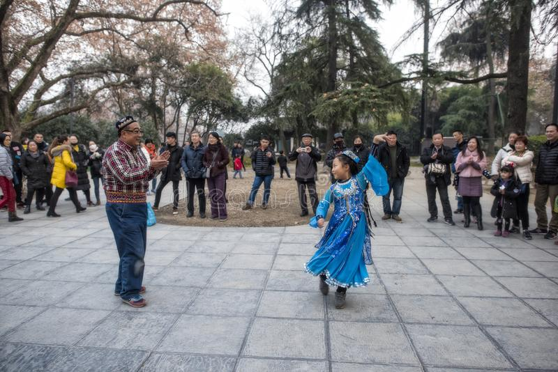 The happy xinjiang dance in nanjing xuanwu lake park. stock image