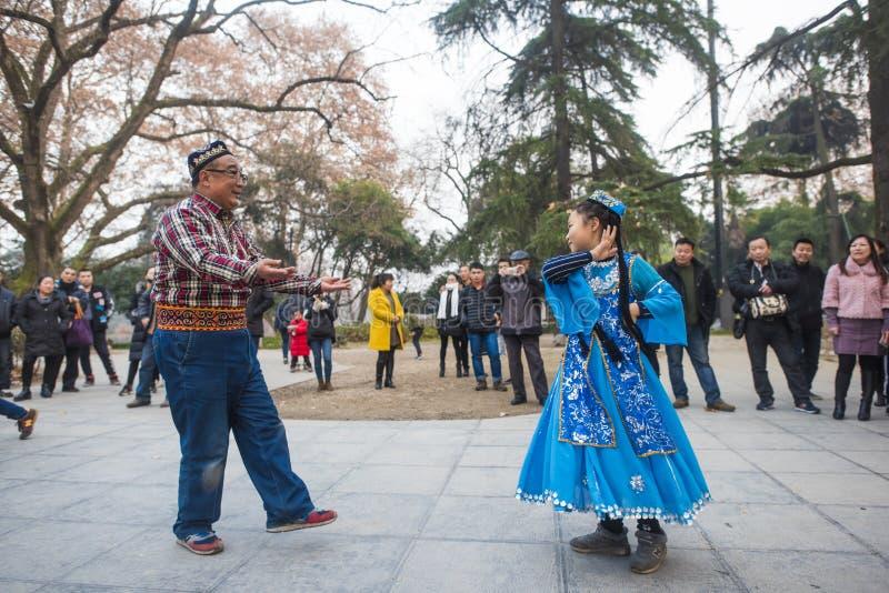 The happy xinjiang dance in nanjing xuanwu lake park. stock photography