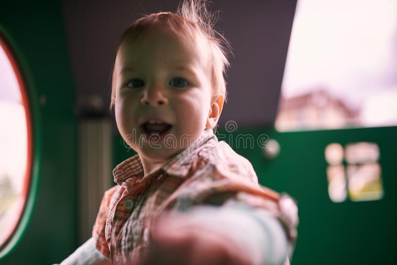 Happy 1 year old toddler playing at the playground royalty free stock image