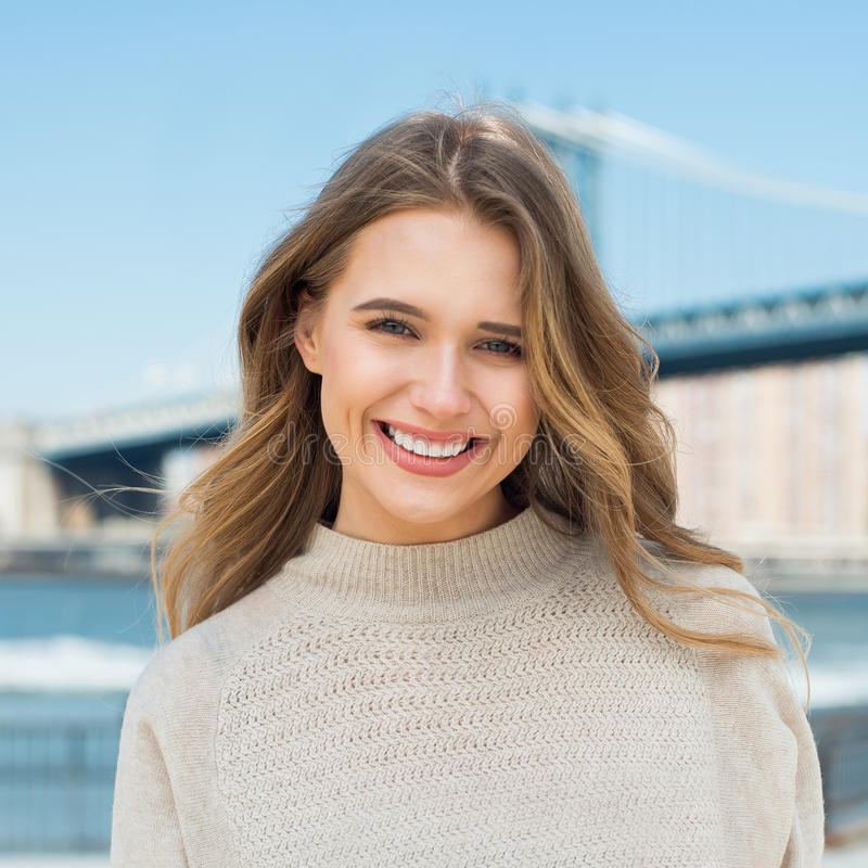 Happy young adult caucasian woman with white teeth smile in the city stock photos