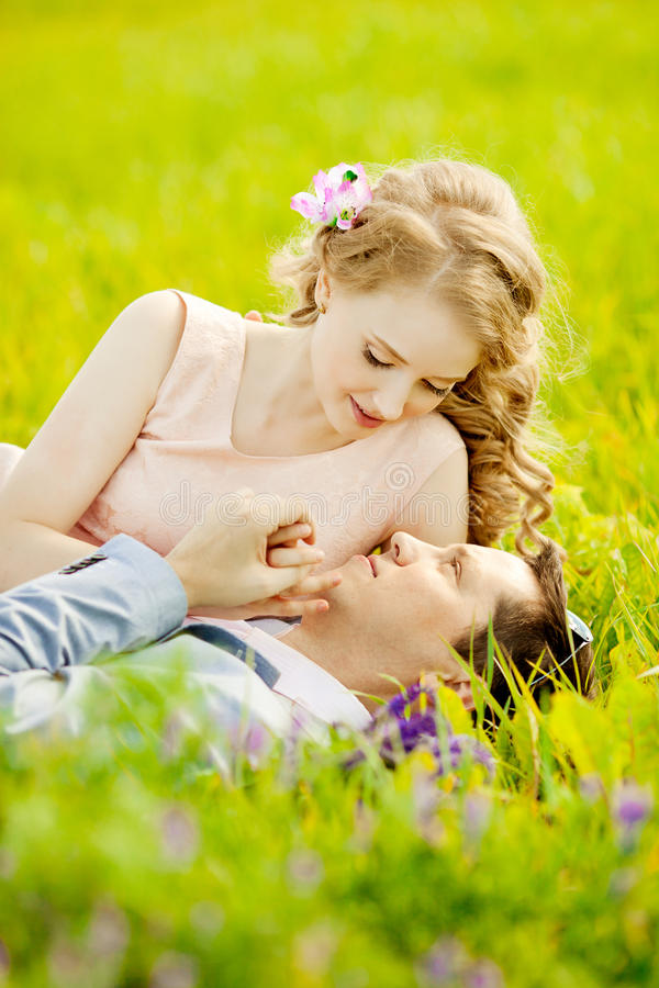 Happy young adult couple in love on the field. Two, man and wom stock photography