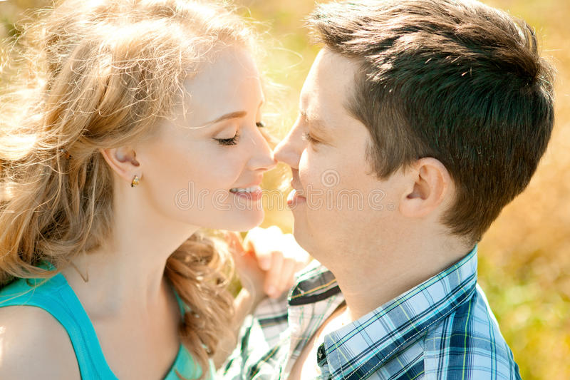 Happy young adult couple in love on the field. Two, man and wom royalty free stock image