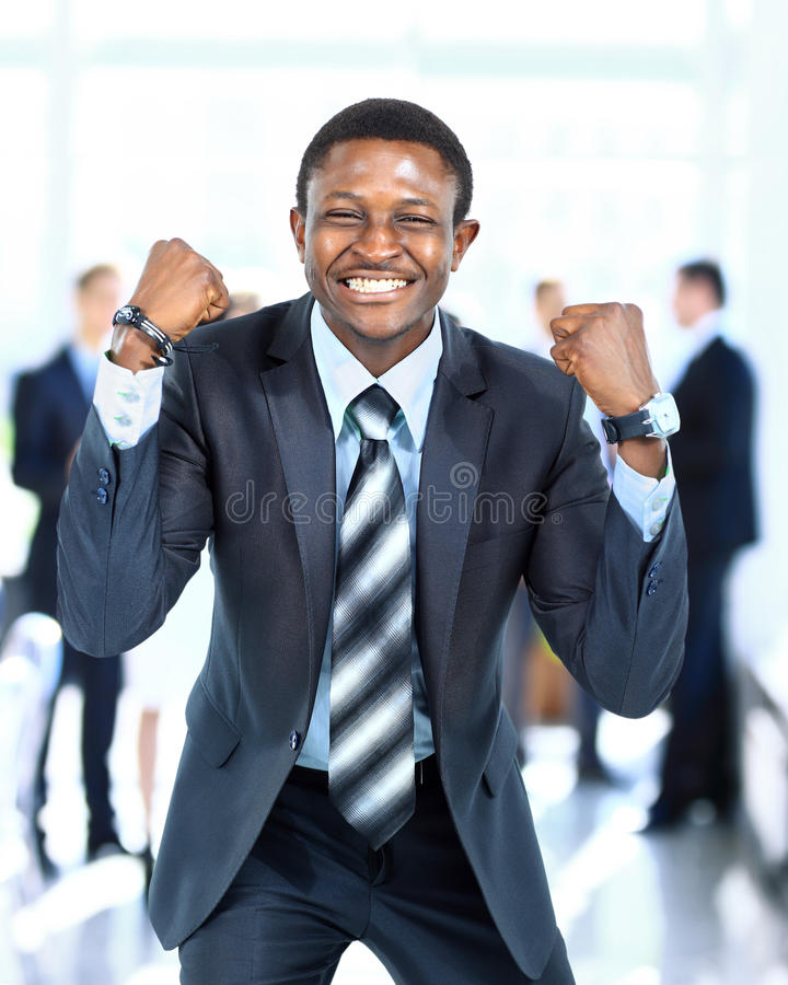 Happy young african american businessman stock photo