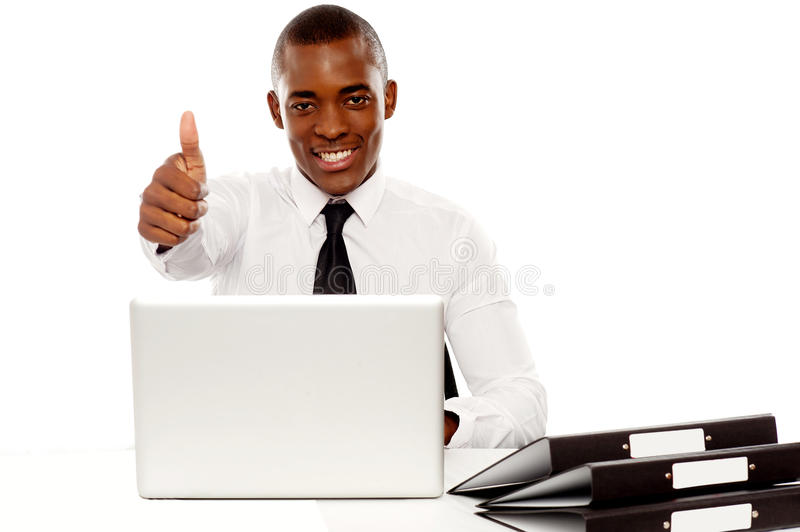 Happy Young African Gesturing Thumbs Up Royalty Free Stock Photography