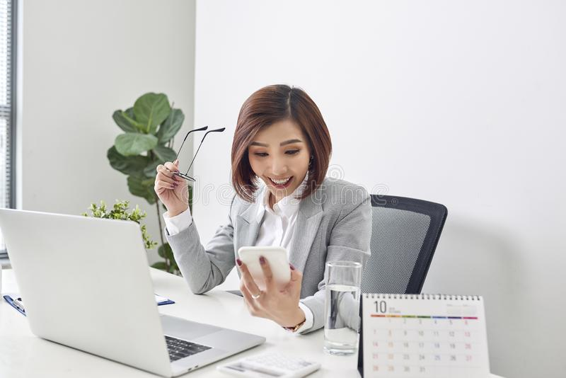 Happy young asian business woman finished her work at workplace stock photos