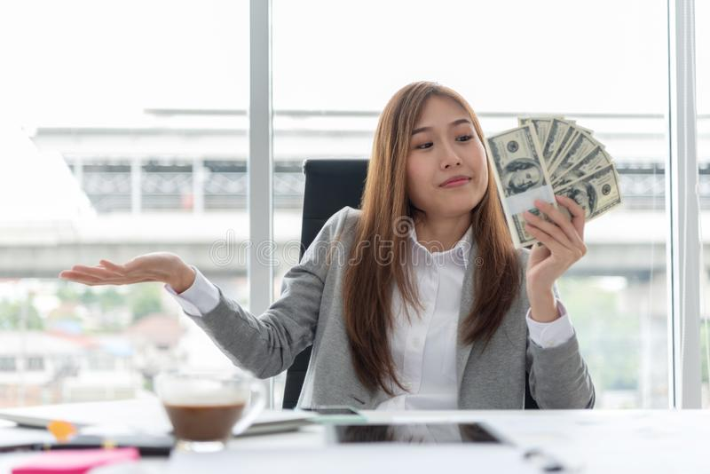 Happy Young Asian Business woman holding money. stock photos