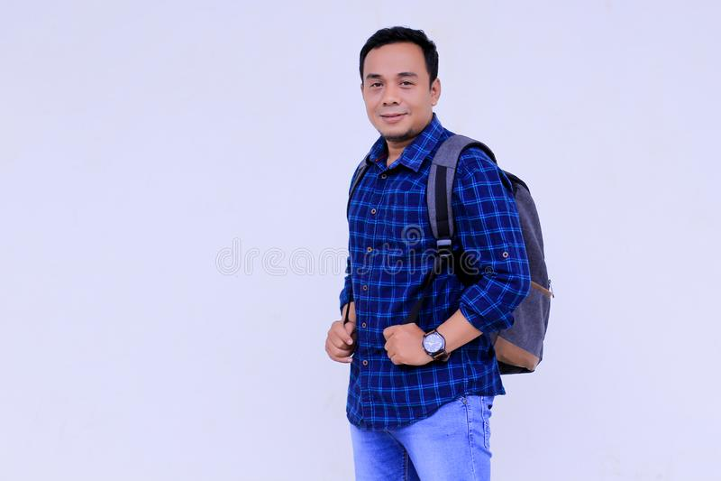 Happy young asian collage student with his ransel stock photography