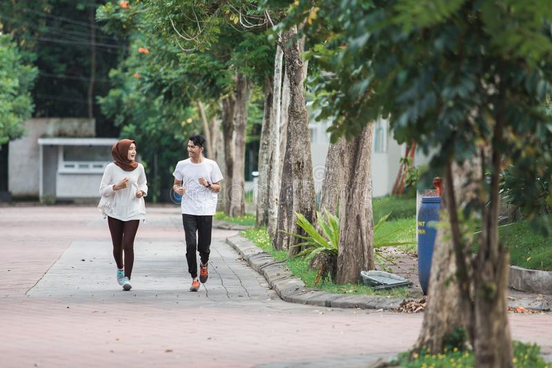 Happy young asian couple exercise and warm up stock images