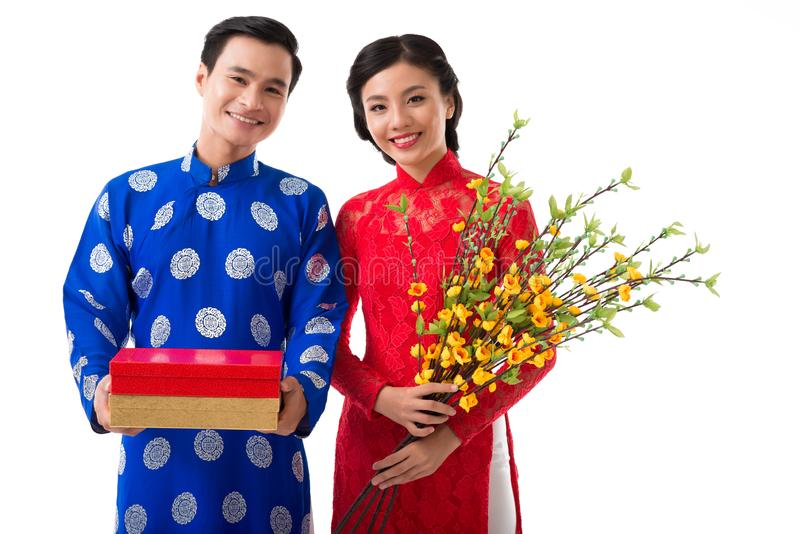 Cheerful couple celebrating spring festival stock photo