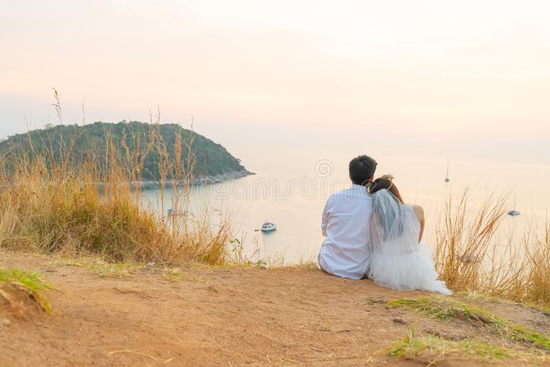 Happy young Asian couple in love having a good time. With sea background royalty free stock photography