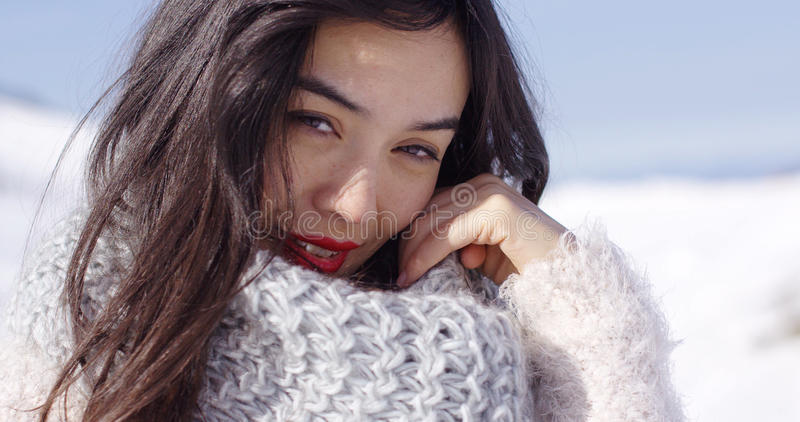 Happy young asian girl enjoys snowy winter stock images
